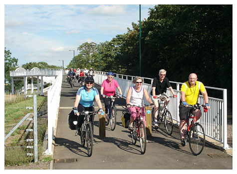 Cyclists approach on bridge